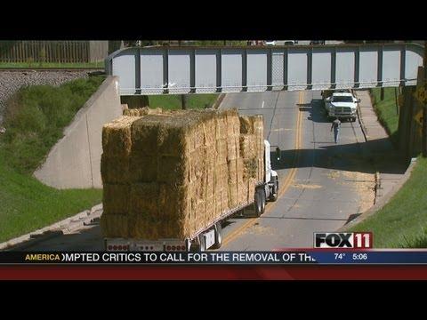 Semi hauling hay gets stuck in De Pere