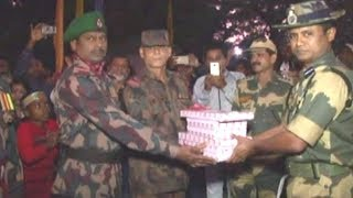 BSF, BGB observe Vijay Diwas, exchange sweets - TIMESOFINDIACHANNEL