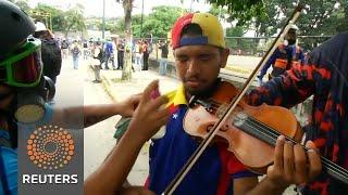 Violence flares in Venezuela, protesting violinist injured - REUTERSVIDEO