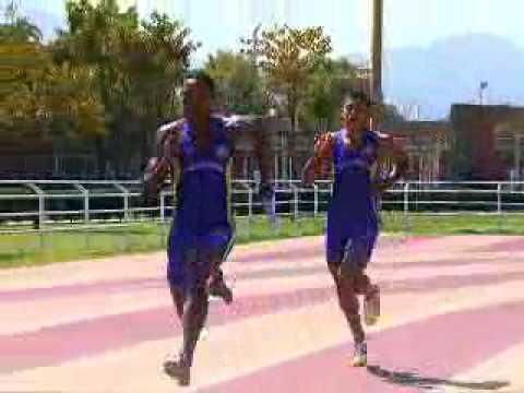 Carrera de relevos - Transferencia del testimonio en la carrera 4x100