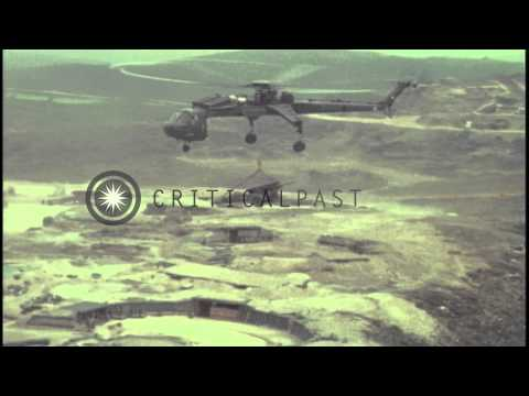 A US Army 160th Combat Aviation Group CH-54 transports a 155mm howitzer in Vietna...HD Stock Footage