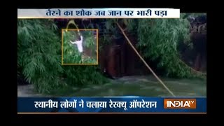 Youth rescued from drowning in Powai lake, Mumbai - INDIATV