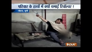 Noida family celebrates Diwali by firing gunshots in air - INDIATV