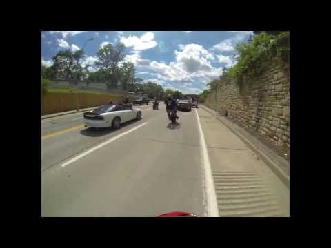 Motorcycle stunt rider hits cop car while riding a wheelie crash fail