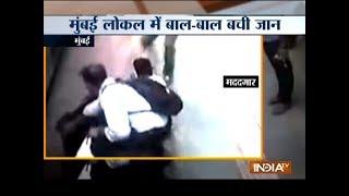 Mumbai: Woman falls while boarding train, two rush to her rescue - INDIATV