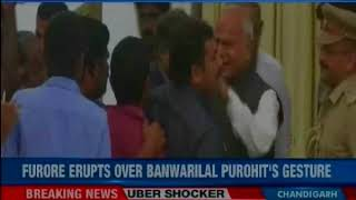 TN Governor pats female journalist on  her cheek; furore erupts over Banwarilal Purohit's gesture - NEWSXLIVE