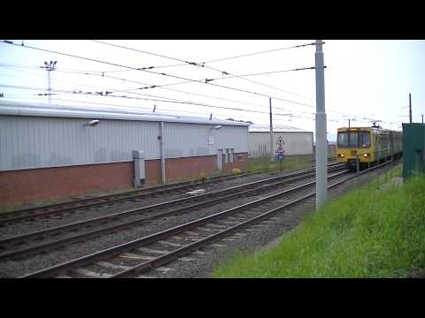 Tyne and Wear Metro-Metrocars 4016 and 4056 passing Gosforth Depot West Yard