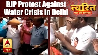 Twarit Mahanagar: BJP workers break earthen pots to protest against water crisis in Delhi' - ABPNEWSTV