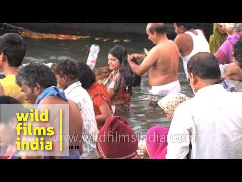 Devotees taking a spiritual bath in river Ganges during Mahashivaratri