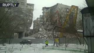 Demolition of apartment block following deadly blast in Russia's Magnitogorsk - RUSSIATODAY