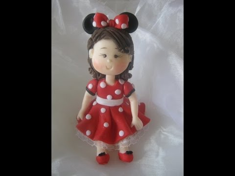 Topo do bolo menina com a roupa da Minnie - biscuit / porcelana fria