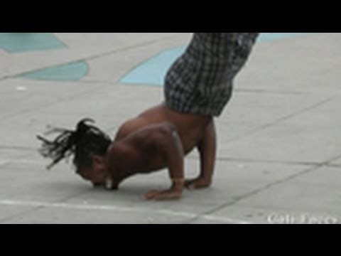 Guy Flips Over 7 People & Stands On His Face - Street Performers -