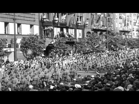 Czech soldiers parade along streets and cheering crowds watch parade in Prague, C...HD Stock Footage
