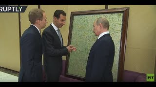 RAW: Putin receives painting from Assad during Syrian leader's visit to Sochi - RUSSIATODAY