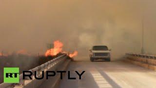 بالفيديو.. سكان مقاطعة في أوكلاهوما الأمريكية يفرون من حريق هائل