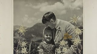 'Fuehrer's child': Photo of Hitler hugging Jewish girl goes on sale in US - RUSSIATODAY