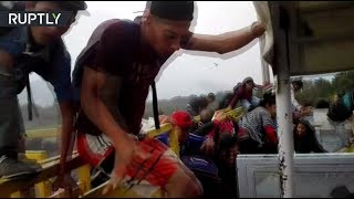 Chaos at Simon Bolivar Bridge: Venezuelans storm the border to Colombia - RUSSIATODAY
