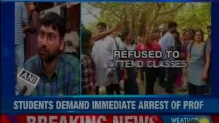 Students stage protest against JNU professor accused of sexually harassing students in the class - NEWSXLIVE