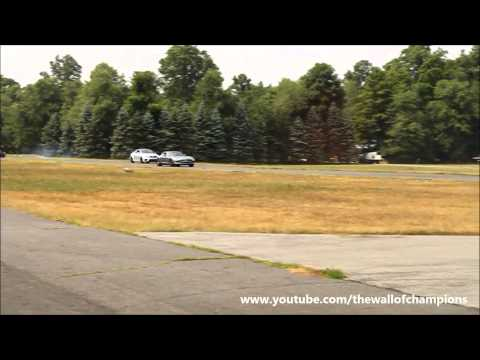 Mercedes Benz C63 AMG Black Series vs. Mercedes Benz SLS AMG Drag Race