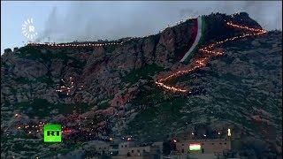 Iraqi Kurds carry torches atop Akre mountain to celebrate Nowruz - RUSSIATODAY