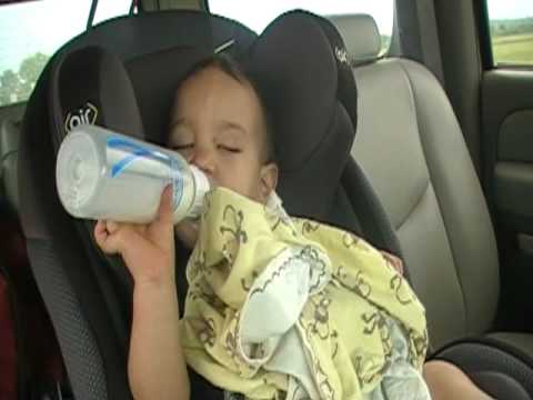 in the car feeding himself.MOD