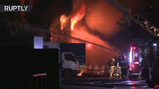 Helicopters, firefighters battle massive blaze at Moscow warehouse - RUSSIATODAY