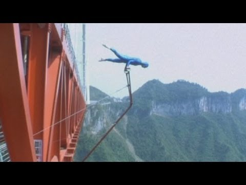 Dangerous stunts: Daredevil acrobat Eskil Ronningsbakken performs on China's Aizhai bridge