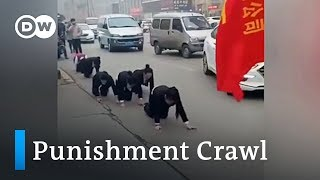 Chinese workers forced to go on punishment crawl on streets | DW News - DEUTSCHEWELLEENGLISH