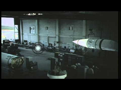 Technicians place Redstone Missile on a transporter at hangar in Cape Canaveral, ...HD Stock Footage