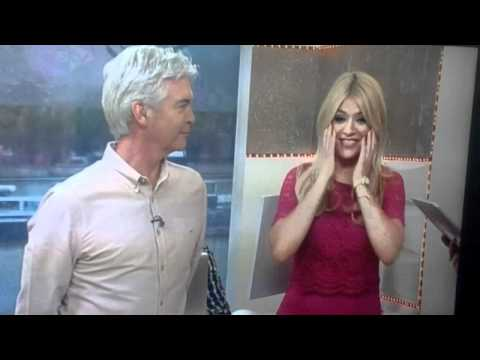 Holly Willoughby blushes over Fifty Shades of Grey biting lip comment on This Morning July 2012