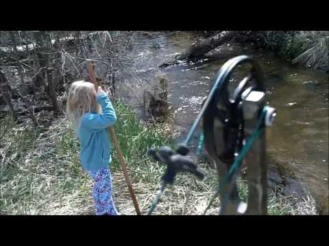 Bowfishing MN creek 27 Carp in 8 min 2011