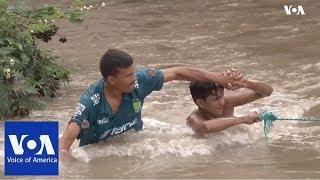 Honduran Migrants Attempt to Cross Border River with El Salvador - VOAVIDEO