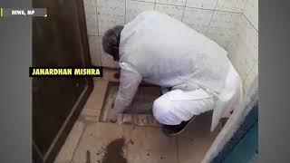 BJP MP Janardhan Mishra cleans a public school toilet - ZEENEWS
