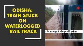 Odisha: Bhubaneswar-Jagdalpur Hirakhand Express gets stuck on a waterlogged train track - ZEENEWS