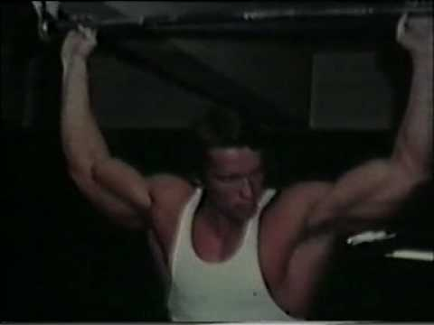 Arnold Schwarzenegger doing pull-up's in the 70's.mpeg