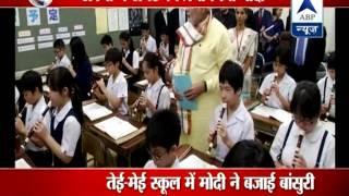 PM Modi turns teacher in Tokyo l plays flute - ABPNEWSTV