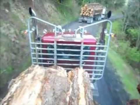 Peterbilt logging truck with a 550 Cat 18 spd. Loud JAKE BRAKE! LISTEN!!!