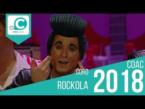 La agrupación Rockola llega al COAC 2018 en la modalidad de Coros. En años anteriores (2017) concursaron en el Teatro Falla como La reina de la noche, consiguiendo una clasificación en el concurso de Cuarto Premio.