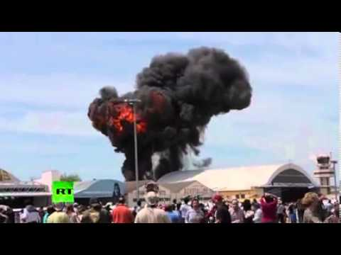 Dramatic footage Vintage stunt plane crashes outside Madrid at aerobatics show
