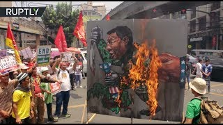 Duterte effigy up in flames as protesters march on Marawi siege anniversary - RUSSIATODAY