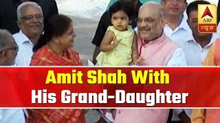 Amit Shah with his grand-daughter, waves at people - ABPNEWSTV
