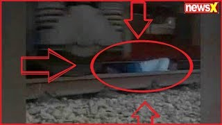 Rajasthan: Man caught lying down on the tracks as a train just goes over him - NEWSXLIVE