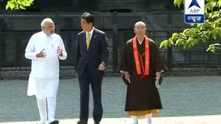 PM Modi visits ancient Buddhist temple in Japan - ABPNEWSTV