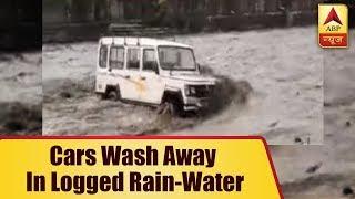 Dehradun: Cars wash away in logged rain-water - ABPNEWSTV