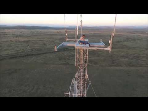 Drone flying around antenna and Base Jump