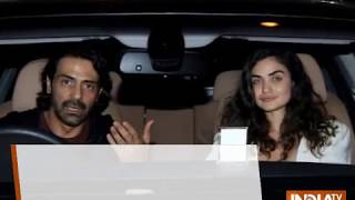 Arjun Rampal and girlfriend Gabriella Demetriades are all smiles for camera on Saturday night dinne - INDIATV