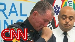 Officer brought to tears recounting school shooting - CNN