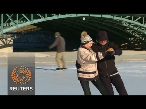 Elderly ice skaters' delightful twists and turns