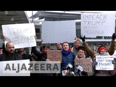 Protesters rally against Trump's travel ban affecting Muslims