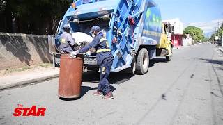 WATCH: Proud garbage collectors